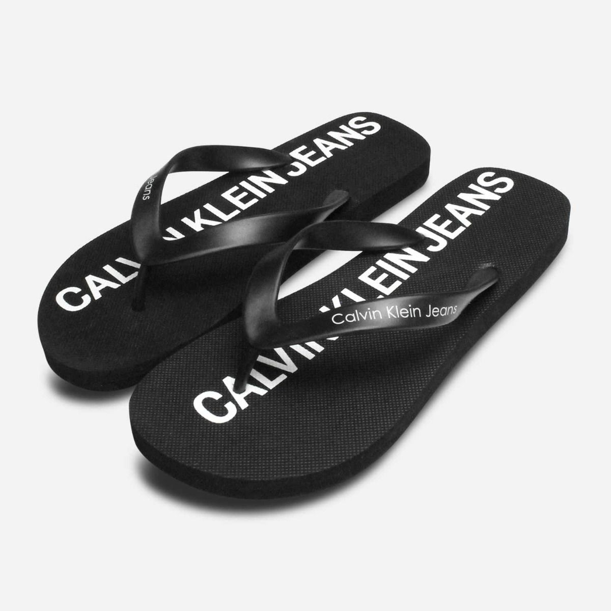 3512cb0ce590 Calvin Klein Mens Errol Jelly Flip Flops in Black