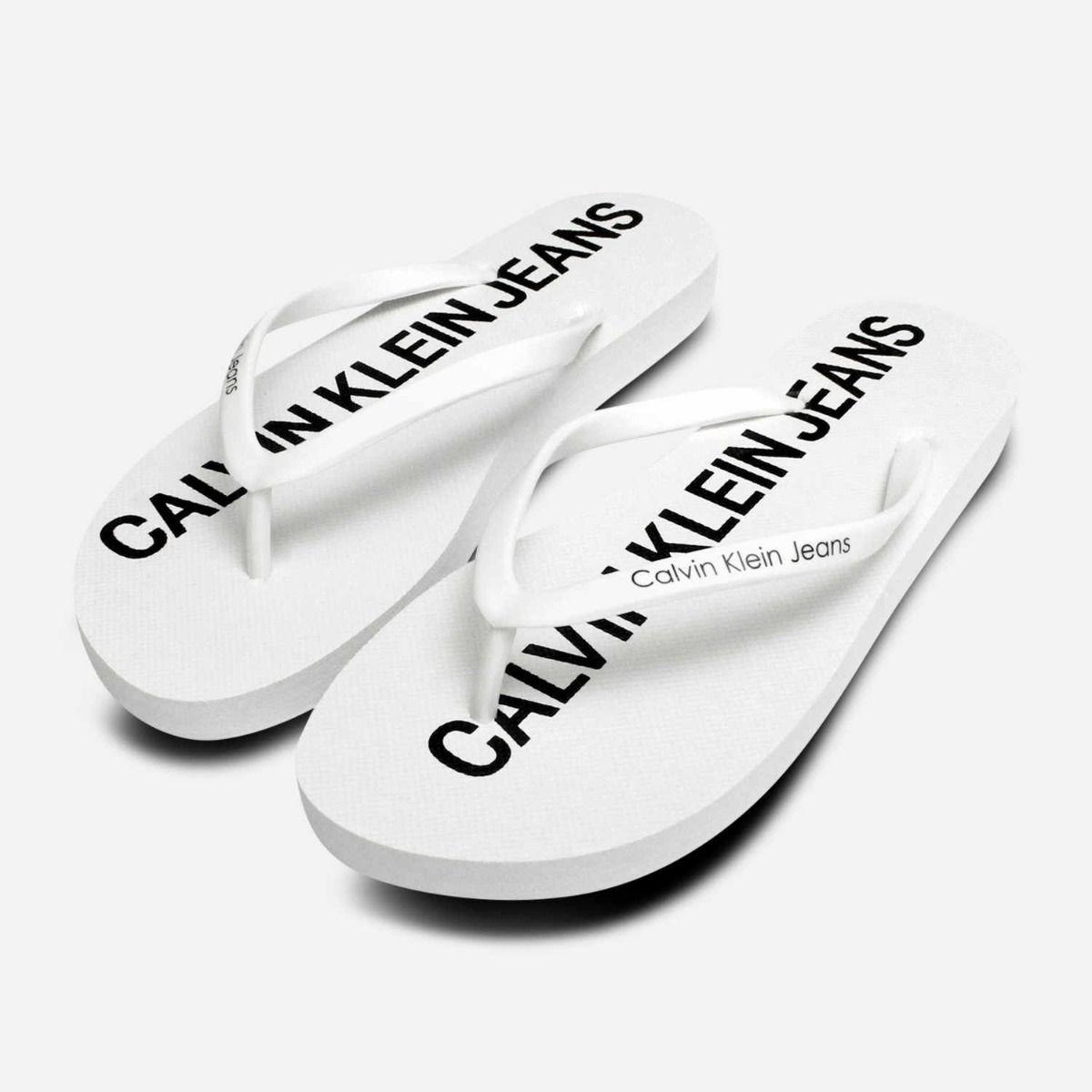 5fabcda8a Calvin Klein Designer Dori Flip Flop Sandals in White