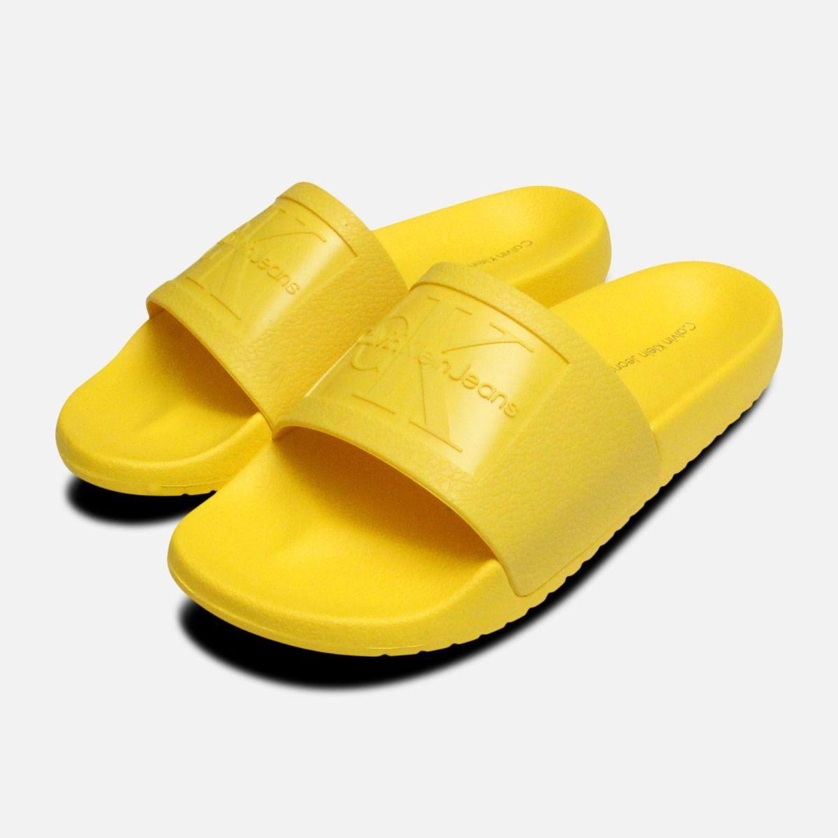 effc62f45a45 Yellow Jelly Calvin Klein Sandals Christie Slides