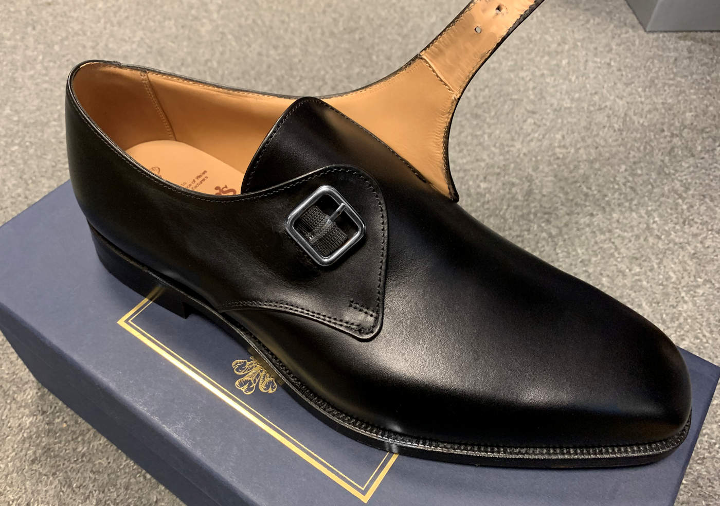 Example of a monk strap shoe opened up
